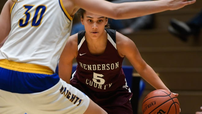 Henderson's Jaylee Carter (5) drives against Castle's Jessica Nunge (30) as the Castle Knights play the Henderson County Lady Colonels at Castle Tuesday, December 5, 2017.