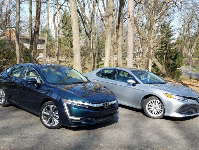 The Honda Clarity Plug-in, left, and Toyota Camry Hybrid