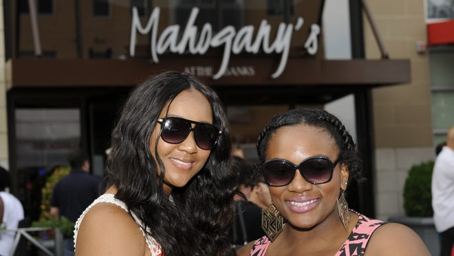 Soul food restaurant Mahogany's at the Banks celebrated its anniversary with an all-day block party last year featuring live music, comedy and karaoke contest. Devin Morgan of Springdale and Candace Reed of Indian Hill.
