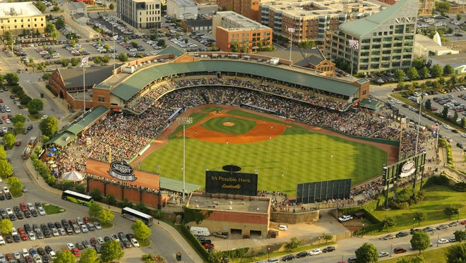 A full house of baseball fans watch the Louisville Bats play the Indianapolis Indians on July 3, 2014.