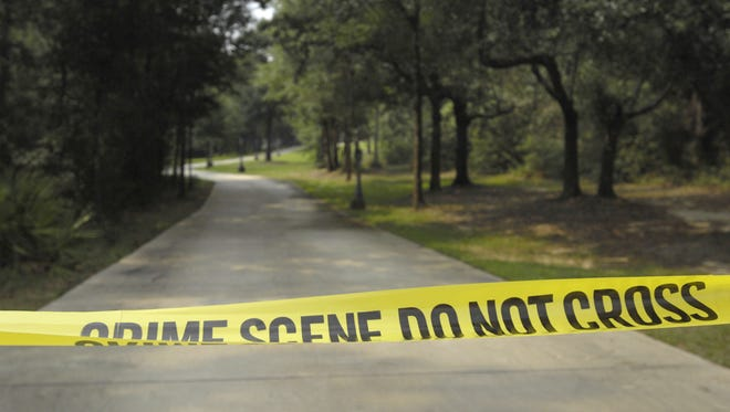The long driveway to the Billings home was blocked by the Escambia County Sheriff?s Office.    Crime scene tape remains at the driveway entrance to the home Bryd and Melanie Billings of Beulah.