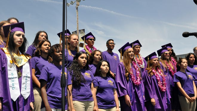 The Salinas High School A Cappella choir sings the national anthem at their 2014 commencement ceremony on Thursday in Salinas.