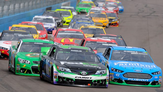 Drivers maneuver last year at Phoenix International Raceway, site of 2014's first Sprint Cup race without restrictor plates.
