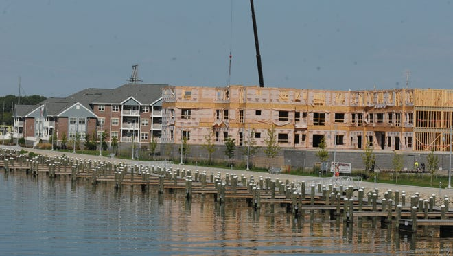 A new 40-unit apartment building will be built along the Fox River between The Rivers Senior Living, left, and the Anthem Apartment Building, under construction on the right.