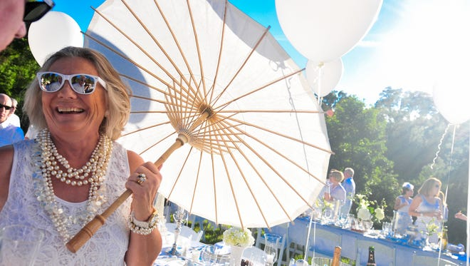 At the 2013 Brandywine in White party, Jan Geddes, of Chadds  Ford, Pa., completes her ensemble with a white umbrella.