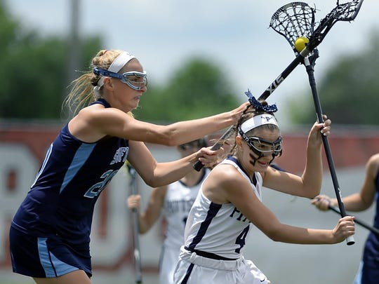 Pittsford's Jillian Quevedo, right, is pressured from behind by Suffern's Elizabeth Trojan during the girls lacrosse Class A semifinal played at SUNY Cortland on Friday. Pittsford's season ended with an 8-6 loss to Suffern-I.