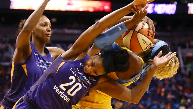 Mercury forward Camille Little has a rebound ripped away by Sky forward Cheyenne Parker during the first half of a game Wednesday at Talking Stick Resort Arena .