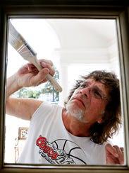 Painter Eric Stambaugh, of Spring Garden, paints the