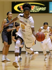 Midwestern State's Micheline Mercelita drives to the