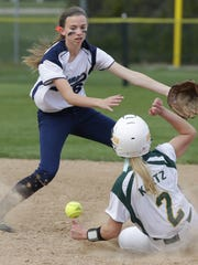 Freedom High School's Brooke Kortz (2) steals second base against Little Chute High School's Megan Lonigro during their softball game Tuesday, May 5, 2015, in Freedom, Wis.