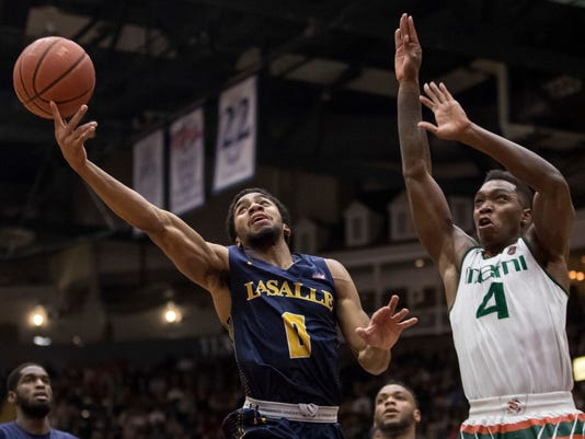 La Salle's Pookie Powell, left, tries to control the ball as Miami's Lonnie Walker IV, right, is defending during the first half of an NCAA college basketball game, Wednesday, Nov. 22, 2017, in Reading, Pa. (AP Photo/Chris Szagola)