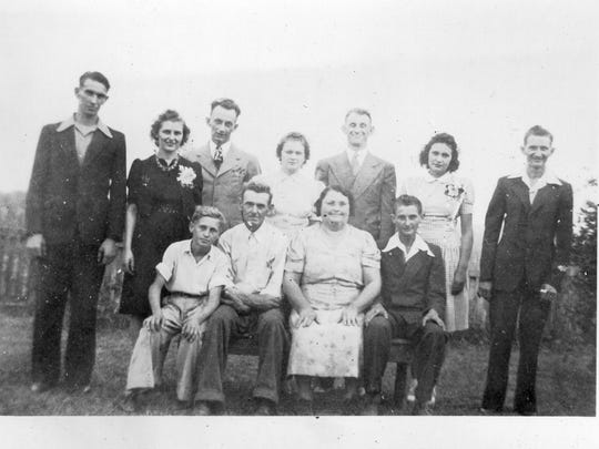 Photo of the Merkley family taken around the time the war started. Front row from left is Leo, Andrew, Catherine and Albert. Back row is Gilbert, Rita, Arthur, Francis, Clarence, Bernadette and Ralph.