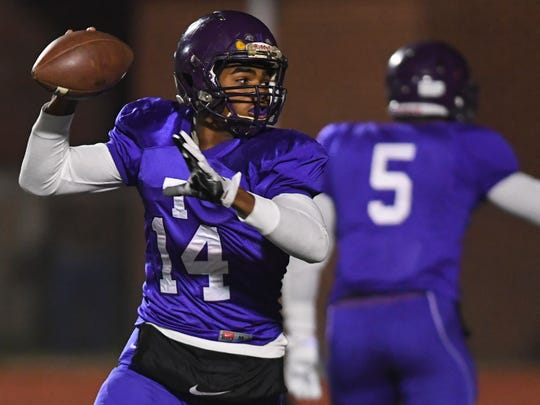 Trezevant quarterback Tywon Johnson rolls out looking for a receiver as the Bears host Waverly Central during Friday night's prep playoff action.