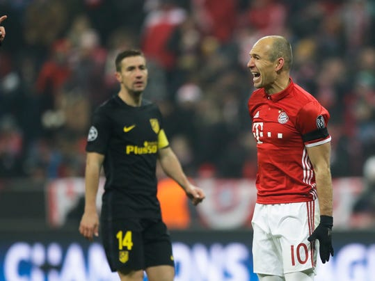 Bayern's Arjen Robben, right, reacts in direction of referee Clement Turpin during the Champions League Group D soccer match between FC Bayern Munich and Atletico Madrid in Munich, Germany, Tuesday, Dec. 6, 2016. In background Atletico's Gabi. (AP Photo/Matthias Schrader)