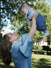 Courtney Calderon and her baby son, Jaxon, at Lincoln Park across from City Hall. New mother, Courtney, is celebrating her first Thanksgiving with her son.  Jim Alcorn/Special to NorthJersey.com