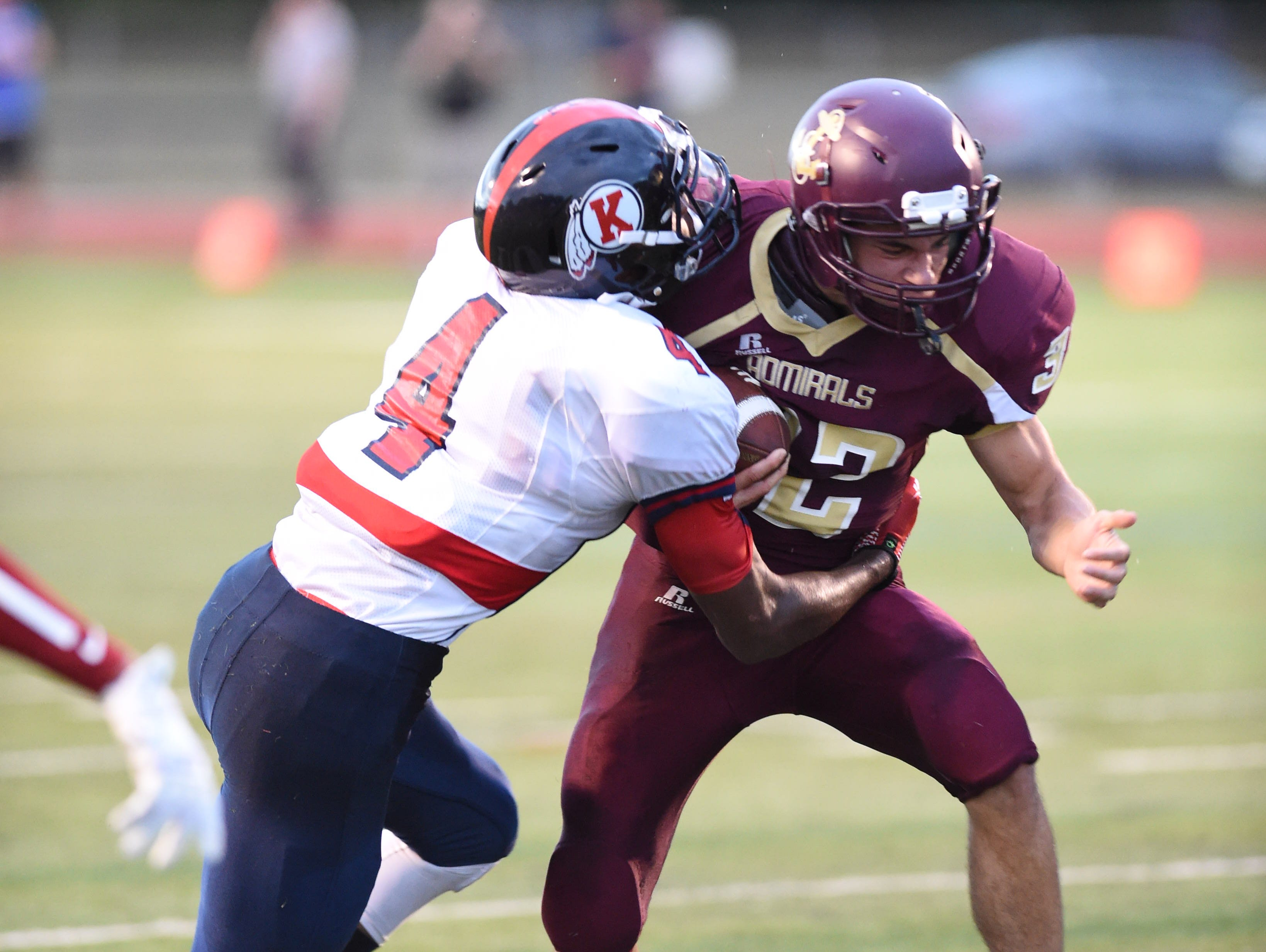 Ketcham's Jyaire Stevens tackles Arlington's EJ Escoto during Friday's game at Arlington High School.