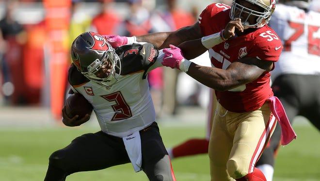 Tampa Bay Buccaneers quarterback Jameis Winston (3) stiff arms San Francisco 49ers linebacker Ahmad Brooks (55) during a 2016 game.