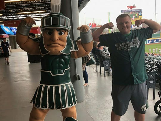 "Mike Sterner poses with Michigan State mascot ""Sparty"" May 3 at Mike Sadler night at Cooley Law School Stadium in downtown Lansing."