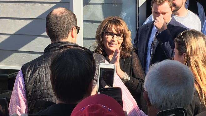 Former Republican vice presidential candidate and Alaska governor Sarah Palin greets the crowd  outside Anderson Pub & Grill in Anderson Township, the first stop of Palin's tour across Ohio to campaign for GOP presidential candidate Donald Trump.