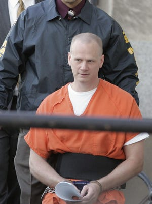 Dustin Lee Honken is led by US Marshals into the Federal Courthouse in Cedar Rapids Oct. 11, 2005, prior to his sentencing. Honken, an Iowa meth kingpin who kidnapped and killed five people, including two young girls, to thwart his prosecution for drug trafficking in 1993, is set to become the third federal inmate to be executed this week. Honken would become the first defendant from Iowa to die from capital punishment since 1963 if his lethal injection takes place as scheduled today in Terre Haute, Indiana.