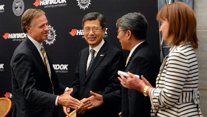 Gov. Bill Haslam, left, shakes hands with Hankook CEO Seung Hwa Suh, center, and Hee Se Ahn, president of Hankook Tire America Corp., second from right, as House Speaker Beth Harwell looks on after a news conference Wednesday in Nashville.