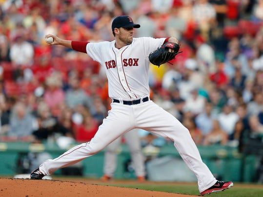 FILE - In this July 5, 2014 file photo, Boston Red Sox's John Lackey pitches in the first inning of the second game of a baseball doubleheader against the Baltimore Orioles in Boston. The Red Sox have traded John Lackey to the St. Louis Cardinals for right-hander Joe Kelly and outfielder Allen Craig before Thursday's, July 31, 2014,  deadline, a person with knowledge of the deal said. The person spoke on condition of anonymity because neither club announced the trade.  (AP Photo/Michael Dwyer, File)