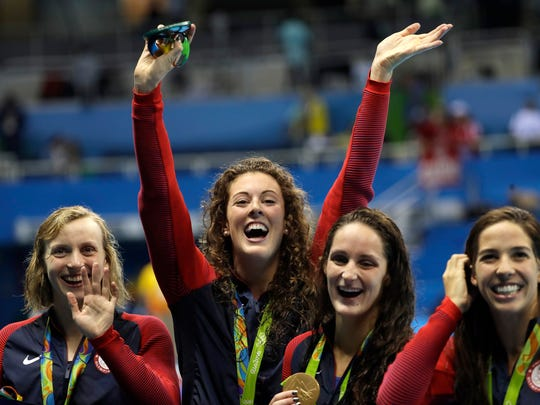Katie Ledecky, Allison Schmitt, Leah Smith and Maya DiRado, from left, during the women's 800-meter freestyle relay medals ceremony in the swimming competitions at the 2016 Summer Olympics, Thursday.