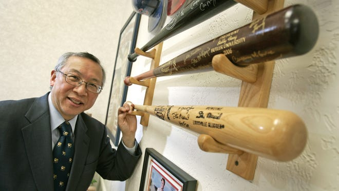 Butler University president Dr. Bobby Fong kept some of the items in his collection of baseball memorabilia in his campus office in Jordan Hall.