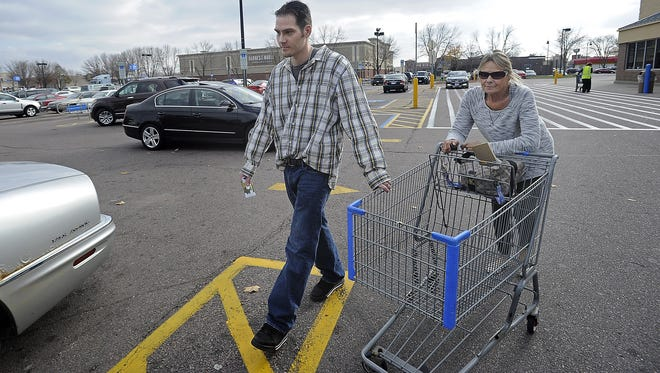 James Marken leaves Walmart on Louise Avenue with his mom, Diane Marken, on Nov. 4. Marken served time in prison after threatening a police officer. Most of the time he was in prison he was waiting a mental health evaluation.