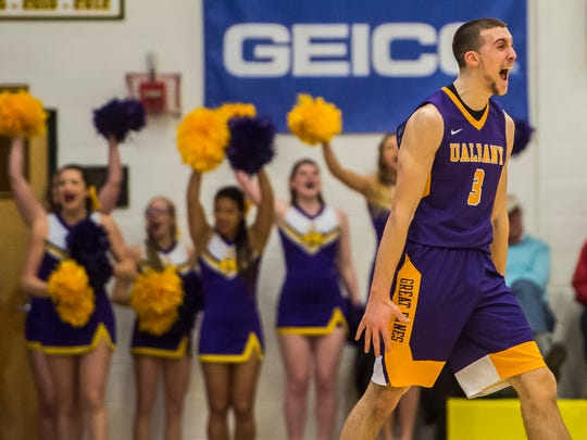 Albany's #3 Joe Cremo reacts to pulling ahead of UVM in the second half of the America East Championship at Patrick Gym in Burlington Saturday, March 11, 2017.