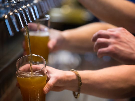 Beers being poured at Four Day Ray Brewing, Fishers, Sunday, Oct. 16, 2016. The official opening of the brewery, which serves food, wine and spirits, is Wednesday, Oct. 19.