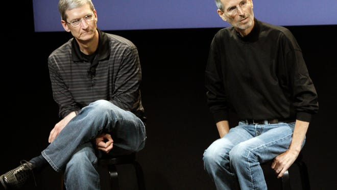 This July 16, 2010 photo shows Apple's Tim Cook, left, and Steve Jobs, right, during a meeting at Apple in Cupertino, Calif. Apple?s potential purchase of headphone maker Beats Electronics for $3.2 billion is just the latest example of how much Cook has deviated from Jobs, who had so much confidence in his company?s innovative powers that he saw little sense in spending a lot of money on acquisitions.