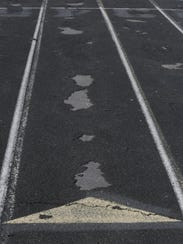 Pieces of the Oshkosh West High School track surface