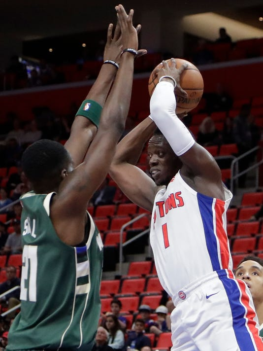 Detroit Pistons guard Reggie Jackson (1) passes around Milwaukee Bucks guard Tony Snell (21) during the first half of an NBA basketball game, Friday, Nov. 3, 2017, in Detroit. (AP Photo/Carlos Osorio)