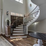 This finished curving staircase was designed, created and installed by Image Design Stairs in the new home of former Titan Cortland Finnegan.