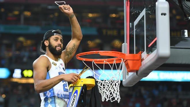 North Carolina guard Joel Berry II cuts down the net after the Tar Heels beat Gonzaga to win the 2017 NCAA men's basketball title.