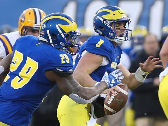 Delaware quarterback J. P. Caruso looks downfield as