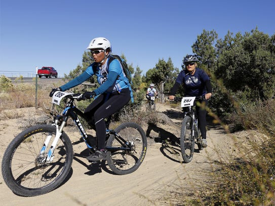 Shorell Dixon, front, rides in the annual Road Apple Rally at Lions Wilderness Park in Farmington on Oct. 3, 2015.