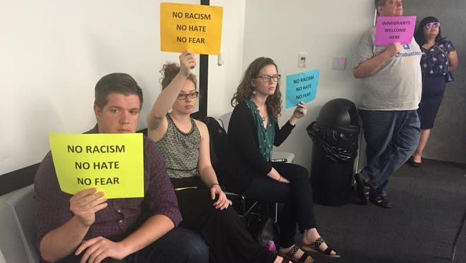 Citizens work for Welcoming City resolution at Des Moines City Council.