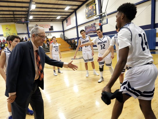 Cathedral head basketball coach Tony Harper is closing
