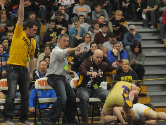 Luxemburg-Casco assistant coach Travis Spude, from left, coach Bob Berceau and assistant coach Brian Jandrin react to points awarded to wrestler Mason Berceau of Luxemburg-Casco during the 138-pound match against Chris Yauch of Two Rivers during the WIAA Division 2 Section B sectional wrestling tournament Feb. 21 at Oconto Falls High School.