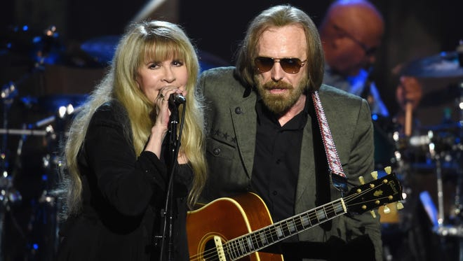 Stevie Nicks, left, and honoree Tom Petty perform onstage during MusiCares Person of the Year in Los Angeles Friday.