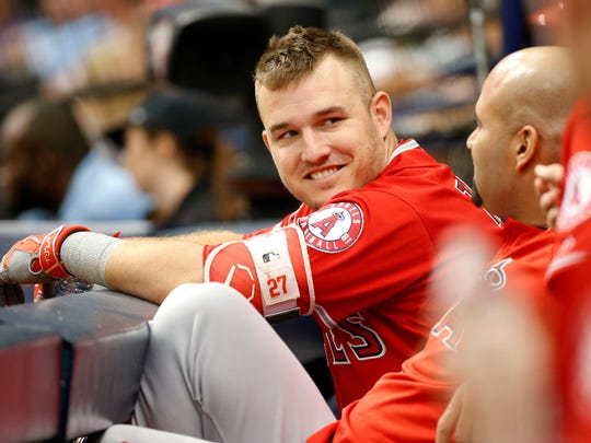 Los Angeles Angels designated hitter Mike Trout (27) smiles as he talks with designated hitter Albert Pujols (5) in the dugout during the second inning against the Tampa Bay Rays at Tropicana Field on May 25, 2017.