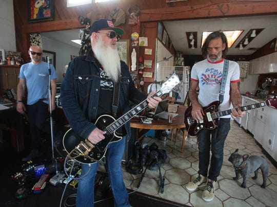 Dave Catching owner of Rancho de la Luna studio, center, with Earthlings? singer Pete Stahl, left, and bass player Brian O'Connor at Rancho de la Luna in Joshua Tree, Calif. Earthlings? will perform with the Mojave Lords at Pappy and Harriet's in Pioneertown, Calif. on Saturday.