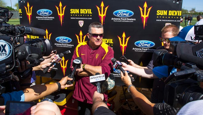 Head coach Todd Graham talks to the media after a practice at the Bill Kajikawa Football Practice Fields in Tempe during the spring football period on March 18, 2014.