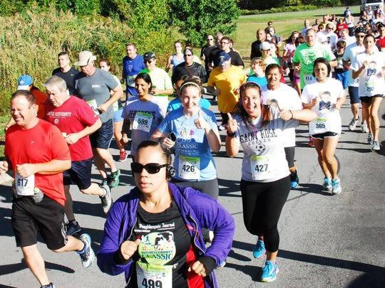 Runners take part in the Dutchess County Classic five-kilometer race on Sept. 20.