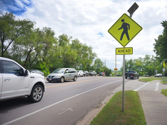 Drivers, bike riders and pedestrians make their way