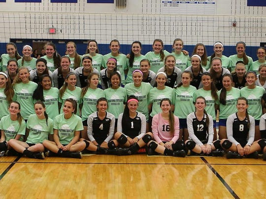 """Before Tuesday's charity volleyball game to benefit the Educational Excellence Foundation's """"No Student-Athlete Left Behind"""" program, Salem and Plymouth players don green T-shirts for the cause and pose together."""