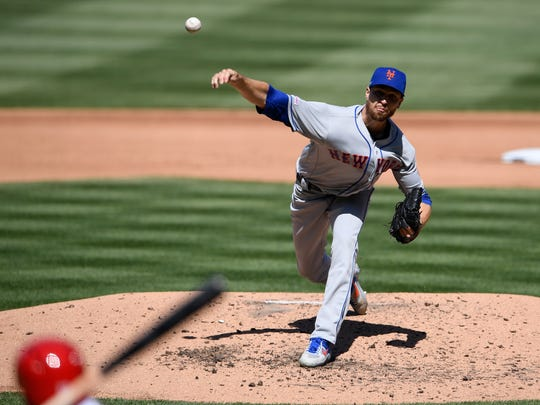 New York Mets starting pitcher Jacob deGrom delivers a pitch during the fourth inning of a baseball game against the Washington Nationals, Thursday, March 28, 2019, in Washington. (AP Photo/Nick Wass)