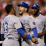 Kansas City's Eric Hosmer, center, celebrates his two-run home run against the Los Angeles Angels with Salvador Perez, left.